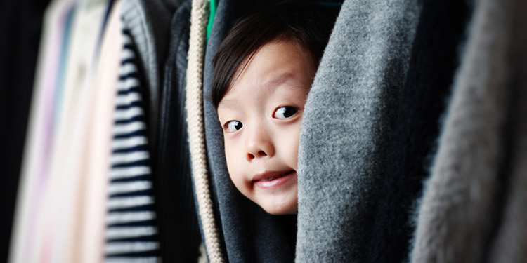 boy hiding in closet depicting how SEO helps you get found