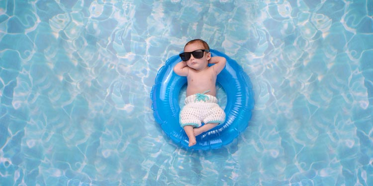 cool baby in tube in pool depicting cool Columbus website design person