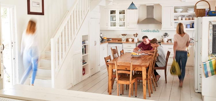 family in kitchen depciting pinpointing people for email marketing services