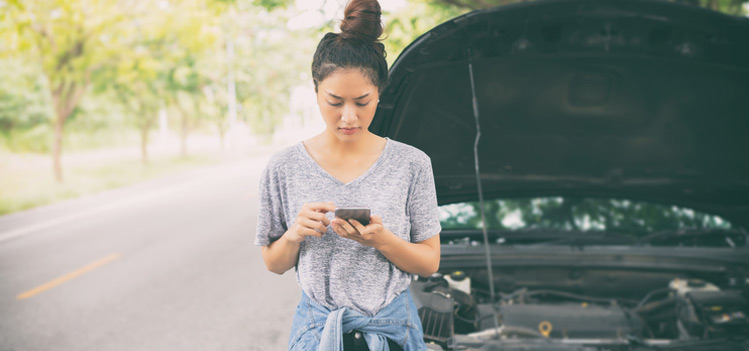 woman by stranded car depicting targeted email services.jpg