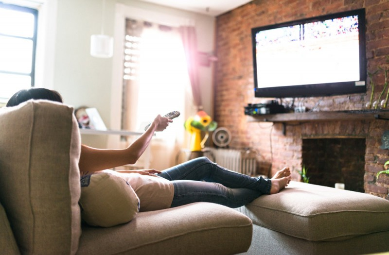 woman on couch watching digital marketing from media buying agency Advantage